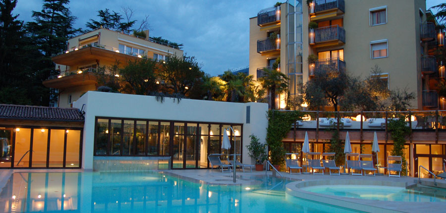 Park Hotel Mignon, Merano, Italy - exterior with outdoor pool at dusk.jpg